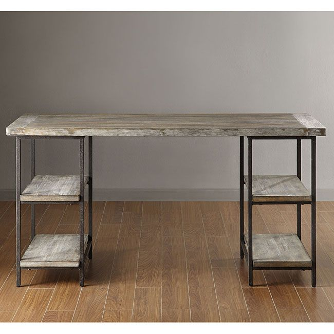 Incorporate an industrial vibe to your home with this Renate desk. Designed with hardwood and metal, this sturdy desk offers side shelving for extra storage and a large work space so you can spread out your work and still have room for a computer or lamp.