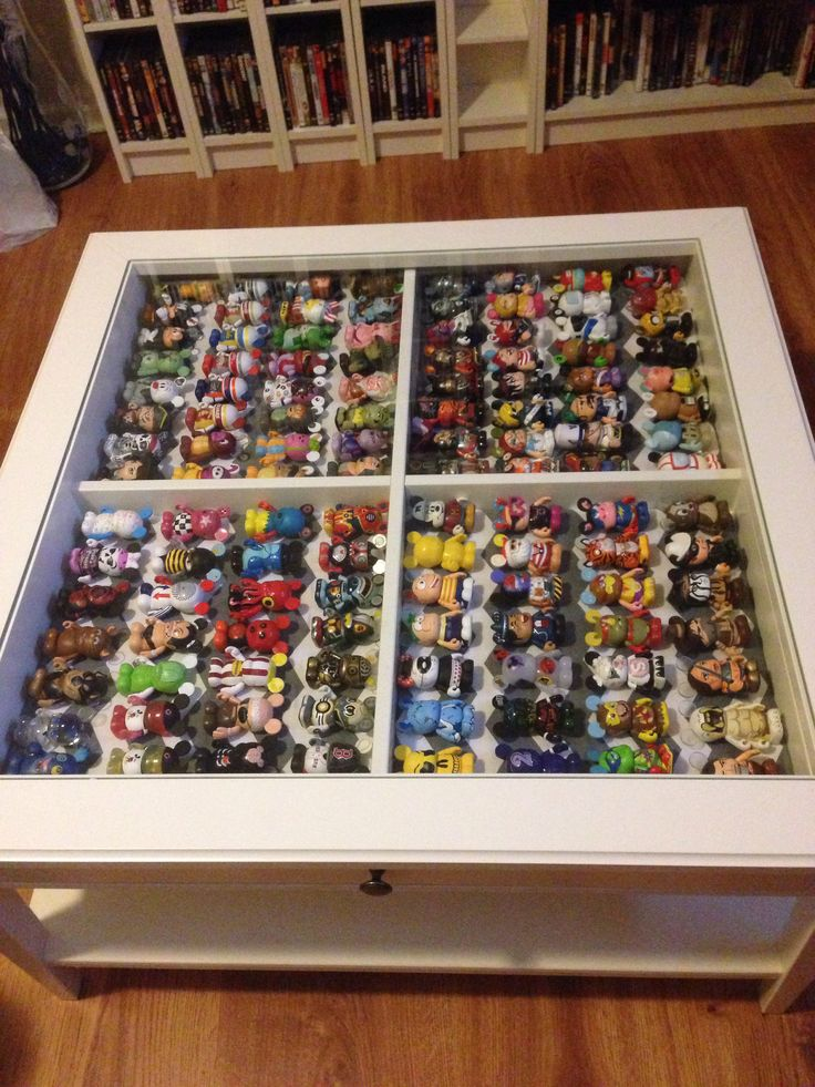 My first DIY project I actually completed. A shadow box coffee table filled with Disney Vinylmations! Great way to store and show them off.
