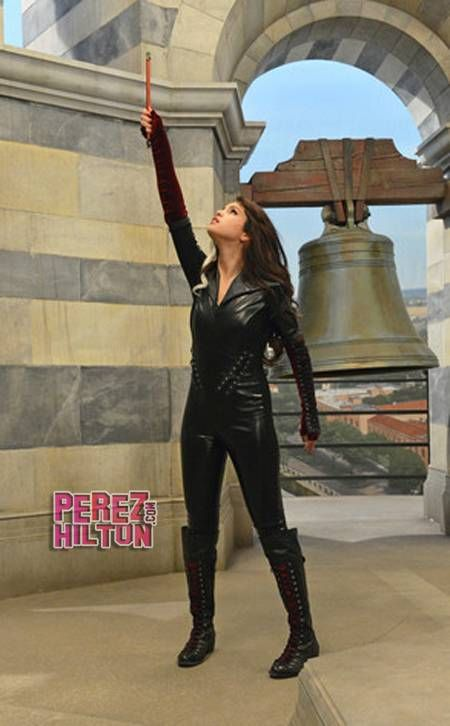 Selena Gomez pictured filming Wizards of Waverly Place in a leather catsuit.