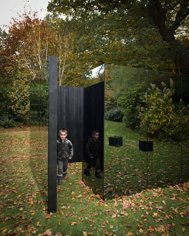 This small garden treehouse, created by British architect Scott Kyson, is covered in sheets of smoked glass and lined in charred Siberian larch.