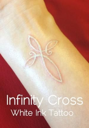 Beautifully done! White Ink Tattoo of an Infinity Cross Actually thinking about getting a small white tattoo... Add in the word believe somewhere and a small butterfly.. Perfect..