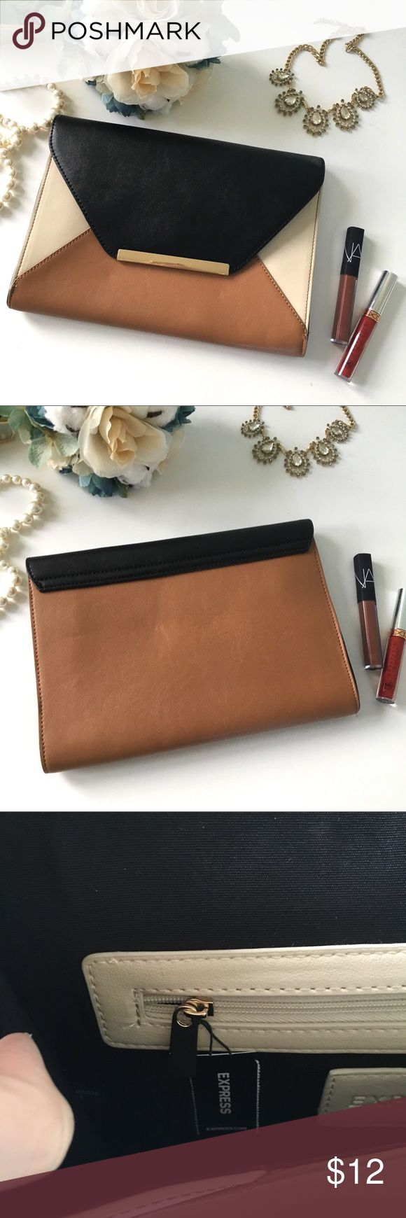 Express Colorblock Envelope Clutch This clutch from Express is new with tags, and has never been used! Gorgeous neutral colors that go with everything, and gold hardware for a touch of chic. Hope you love it! 💕 Express Bags Clutches & Wristlets