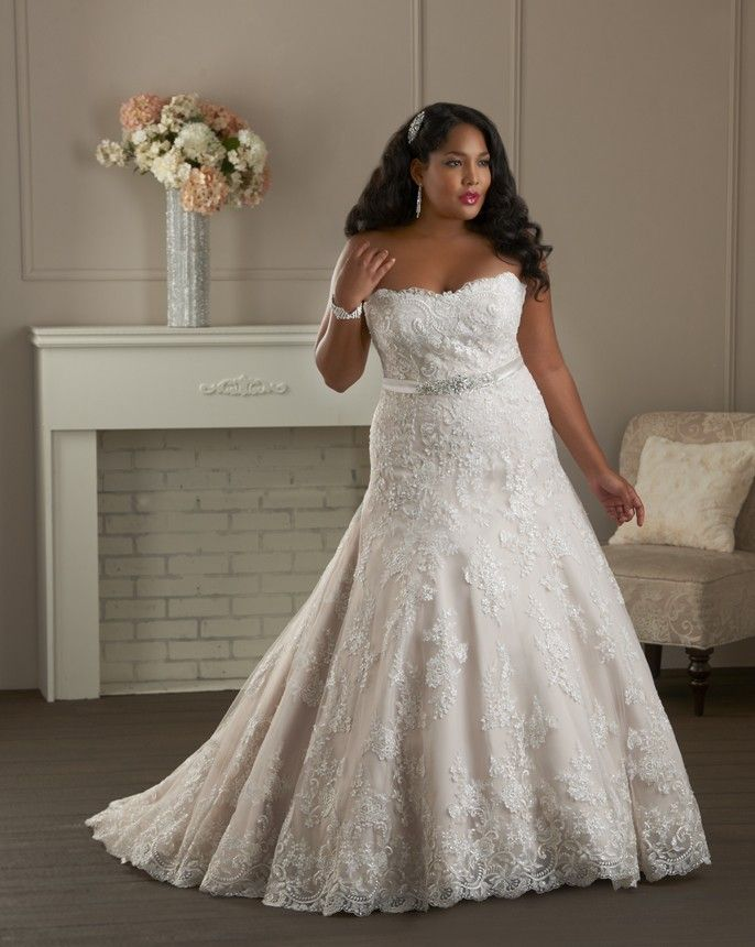 1410, from our Plus Size collection is a flattering fit with a beautiful lace overlay and a beaded belt.