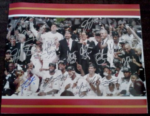 This 16x20 Miami Heat Team Signed Photograph has been personally hand signed by 2012/2013 Miami Heat Basketball Team including Mario Chalmers, Chris Bosh, Joel Anthony, Shane Battier, Chris Andersen, Norris Cole, Juwan Howard, LeBron James, James Jones, Rashard Lewis, Jarvis Varnado, Dwyane Wade, Udonis Haslem, Ray Allen and Mike Miller.