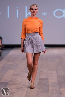 Elik & Afsi collection. A splash of orange with a classic high waisted skirt with pleating for extra detail.