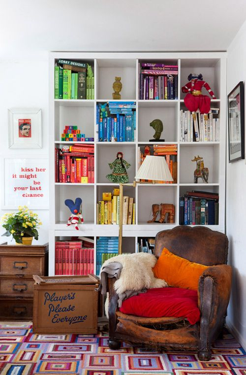 I like the color coordination of the boxes, how they are stuffed to the max with books, and the single figuring in the others.  This is so me :)