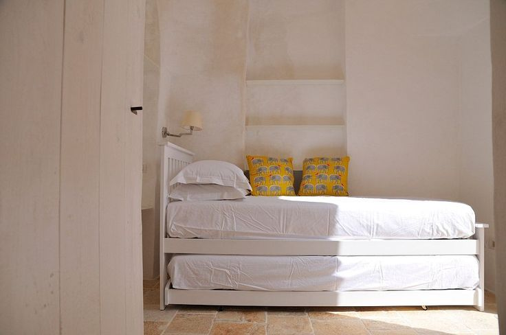 Cisternino villa rental - Two single beds with glass door out to internal courtyard in Cisternino