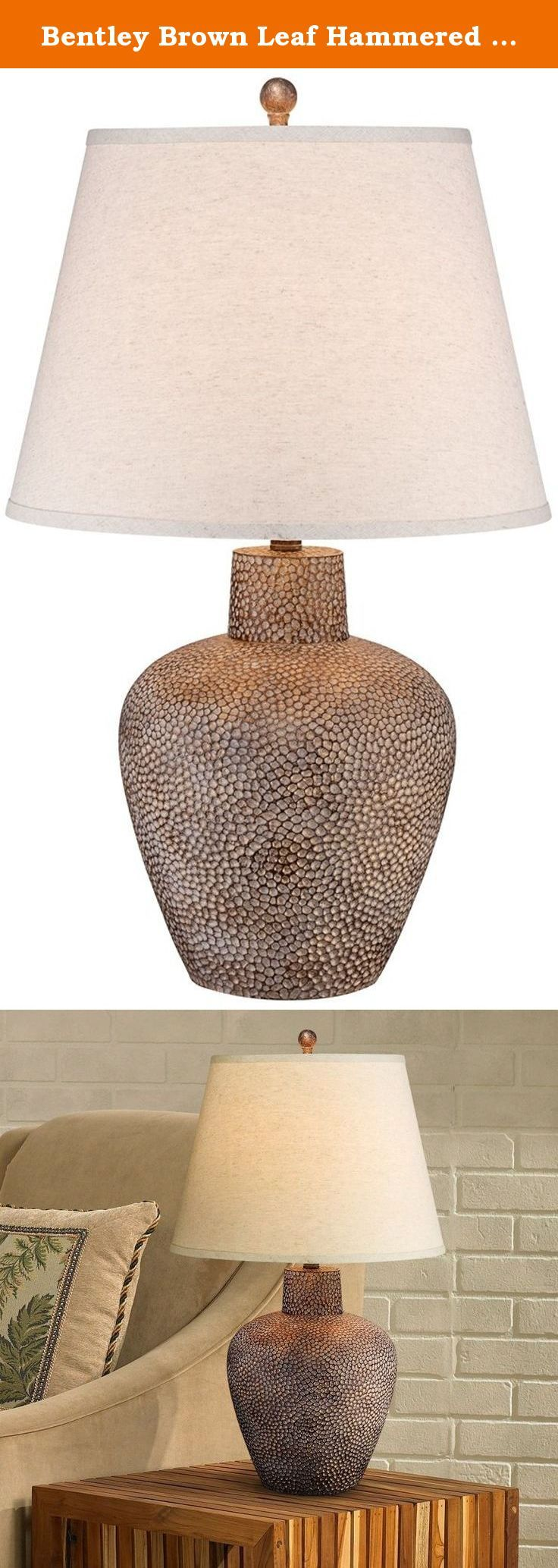 Bentley Brown Leaf Hammered Pot Table Lamp. This attractive table lamp boasts a beautiful hammered base in a shimmering brown leaf finish. Elegantly topped with a beige tan shade, this design is a great way to add light and style to a room. Inspired by Southwestern and Western style decor. - Bentley Brown Leaf table lamp. - Hammered metal texture. - Brown leaf finish. - A wonderful look for Southwest or Lodge style homes. - Beige tan shade. - Resin base. - Maximum 150 watt bulb (not...
