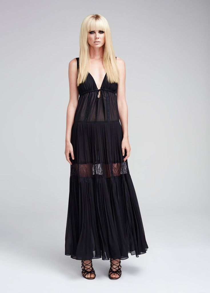The Shadows Lace Dress is a feminine and sensual maxi dress.  This fluid style is paneled with sheer lace. The lining hits mid-thigh for an edgy twist.   Styling Notes: Wear this feminine piece with killer heels for evening or pair it down for glamorous resort wear with stylish flats.