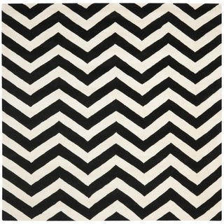 @Overstock - A contemporary chevron design and dense, thick pile highlight this handmade rug inspired by Moroccan patterns with today's updated colors. This floor rug has a black background and displays stunning panel colors of ivory.http://www.overstock.com/Home-Garden/Handmade-Chevron-Black-Ivory-Wool-Rug-7-Square/7347583/product.html?CID=214117 $284.99