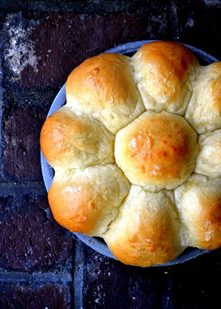 Hawaiian Sweet Rolls - Light and fluffy sweet rolls with a hint of pineapple and coconut. Perfect paired with BBQ or enjoyed warm with butter!!