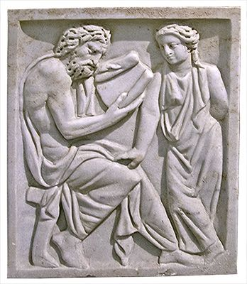 central panel of a marble sarcophagus, Roman, found in the Via Praenestina, third century CE.This relief depicts a seated male teacher holding a scroll and reading to a female student. Rome, Tabularium (Capitoline Museums). Credits: Barbara McManus, 2007