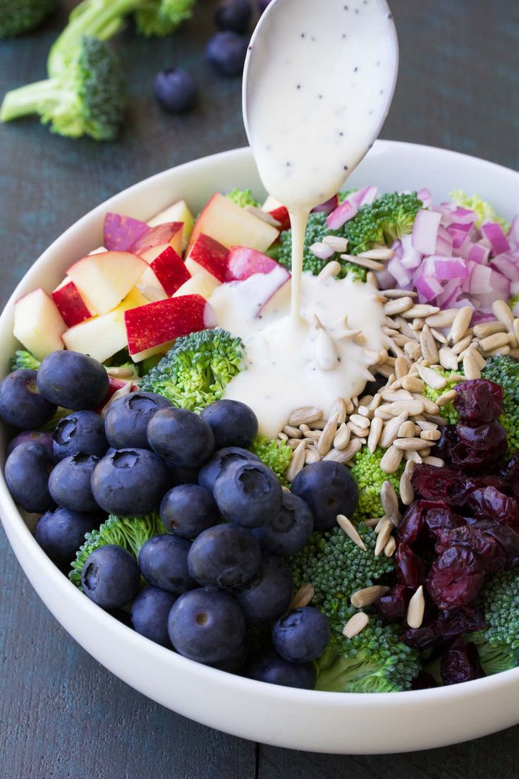 Best Ever No Mayo Broccoli Salad with Blueberries and Apple! A healthy and easy summer side dish with a creamy poppyseed dressing and dried cranberries.