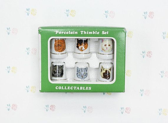 """6 Vintage Cat Thimbles by Regal Greetings & Gifts  Item No. 1501 Made in Taiwan Package Measures: 4.25"""" x 3.25"""" x 1"""" Condition: Light wear on the package, thimbles like new and protected in styrofoam insert.  ***** More Stuff for Cat Lovers: https://etsy.me/2IiMbqT  ***** More"""