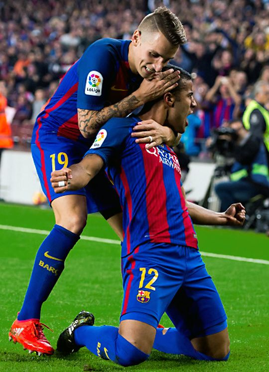 Rafinha celebrates with Lucas Digne after scoring the opening goal during the La Liga match between FC Barcelona and Granada CF at Camp Nou stadium on October 29, 2016.