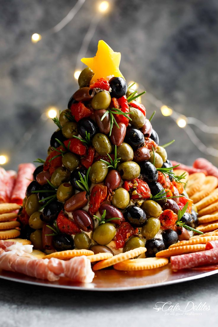 Antipasto Cheese Ball Christmas Tree is a showstopper! Forget antipasto platters! This cheeseball is even better with a sun dried tomato cream cheese dip!