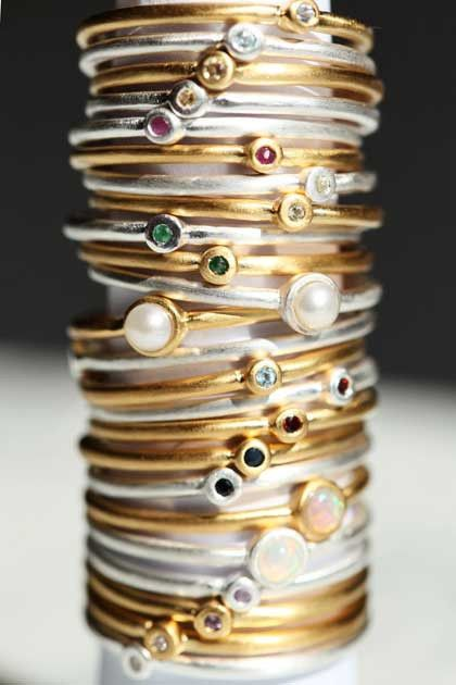 Mini semi precious birthstone rings in silver and gold are perfect for stacking.   A modern take on a personal piece.  Tell your story.  Free shipping worldwide.