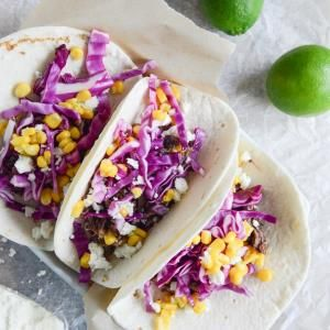 Crockpot Smoky Brisket Tacos with Shredded Cabbage + Sweet Corn.