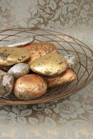 Strike it rich with this easy centerpiece, crafted from a discount-store basket and quarry rock. Medium-size river stones coated with silver, gold, and copper leaf look fabulous in a wire bowl sprayed with bronze metallic paint.