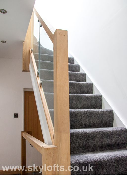 Glass balustrade for stairs up to master bedroom with ensuite loft conversion in Farnborough Hampshire