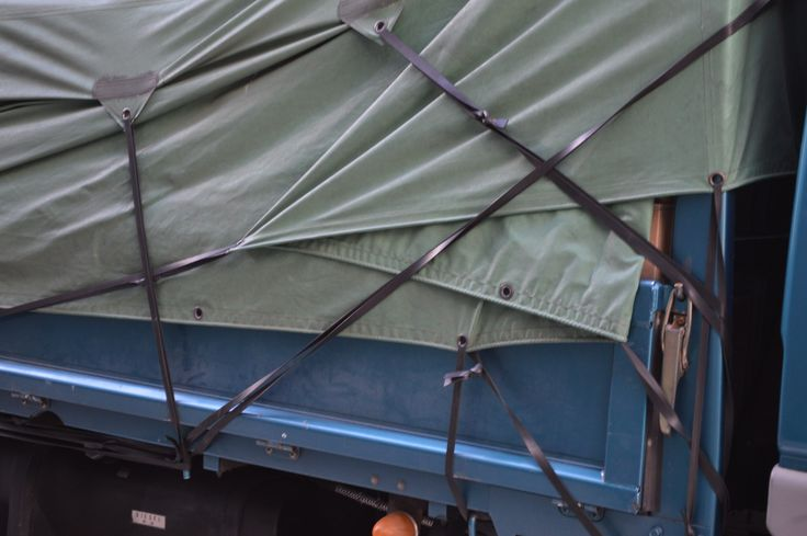 Sheets on back of truck strapped down.  -Print idea -Attaching pattern pieces with long stiches or ropes