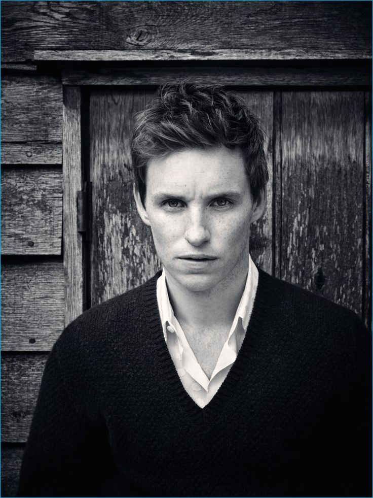 English actor Eddie Redmayne wears a v-neck sweater and smart shirt for Rhapsody magazine.