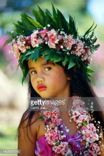 French Polynesia, Tahiti, portrait of young girl wearing head lei B1691