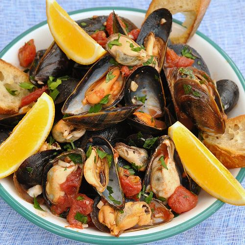 Neapolitan Style Mussels: Use gluten-free bread (cut into rounds with a small biscuit/cookie cutter) to make crostini & proceed with recipe.