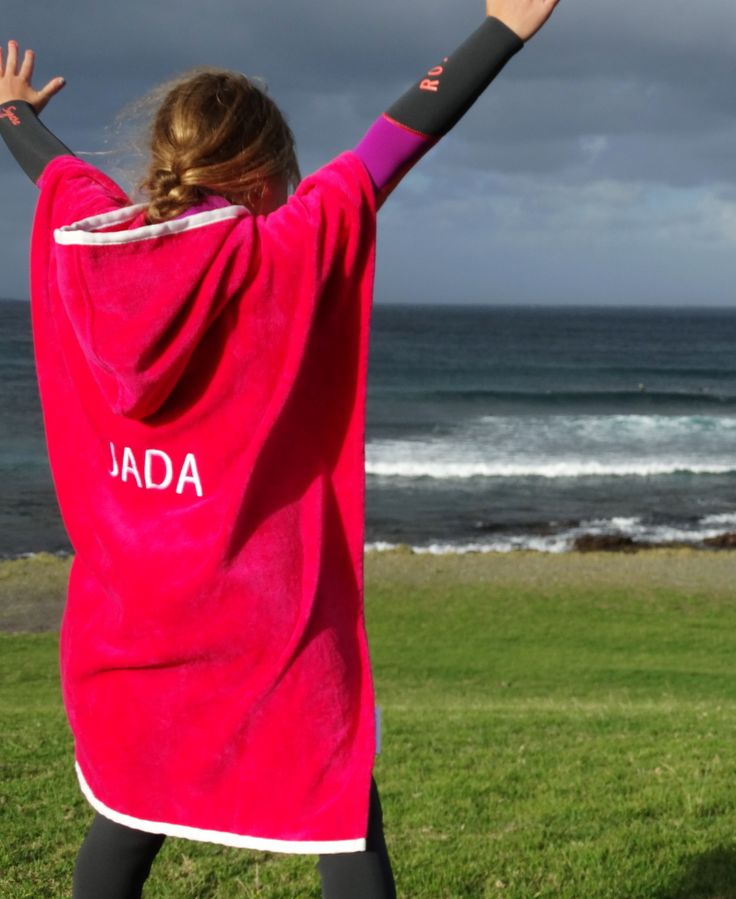 This is Jada Thomas, a small surfer with big dreams keeping warm on the beach with her sponsored custom Nautical Mile Hoodie Towel.  www.nauticalmile.com.au