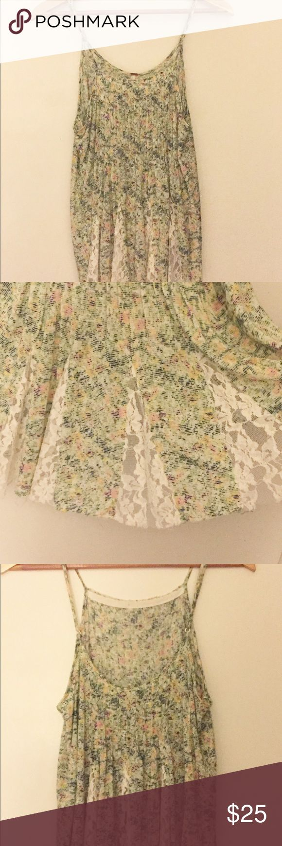 [Free People] Floral Lace Tank Light, airy, and comfortable top with adjustable straps and lace details. Can be worn with certain strapless bras, a bralette or backless bra. Excellent condition. No trades. Free People Tops