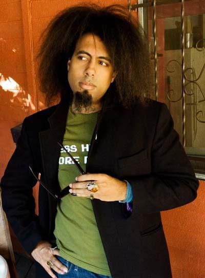 Artist. Musician. Comedian. His hair has a mind of its own. The one and only Reggie Watts.