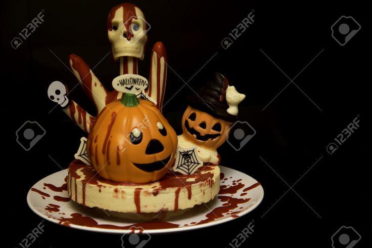 Halloween chocolate decoration on cake with dark background