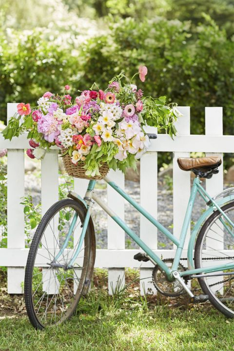 """Retro Bike Basket:  An antique bike with a flower-filled bike basket is the perfect welcome piece for any event or even a beautiful addition to the garden,"""" Kiana says. Place a water-filled container inside the basket and add flowers. """"I used a variety of spring flowers like peonies, ranunculus, and tulips with dogwood, garden roses, poppies, and hydrangeas."""""""