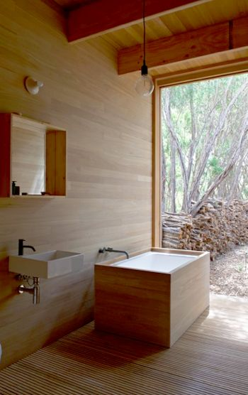 Beautiful wood wrap around tub.