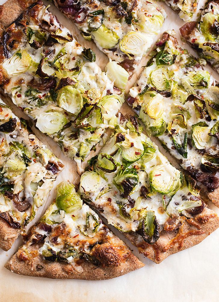 Brussels sprouts pizza with balsamic red onions from @cookieandkate, plus 19 more creative pizza recipes ranging from Nutella to tandoori chicken to caramelized apple bacon + blue cheese pizza