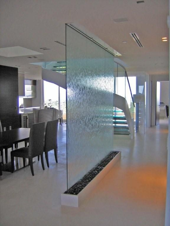 Water wall by Vertical River Designs as screen