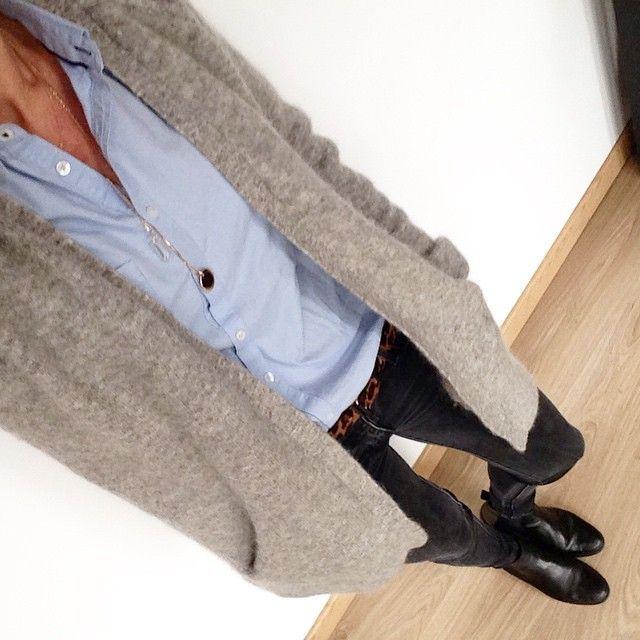 Blue button down, taupe cozy cardigan, black boots, leopard belt
