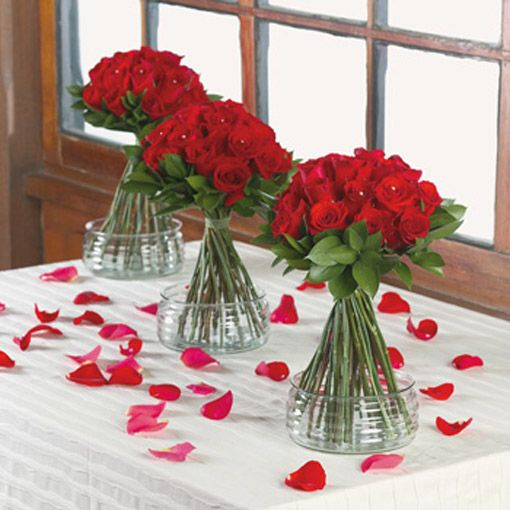 Simple long stem red rose centerpiece with short glass