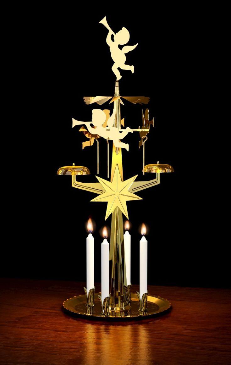 Door de warmte van de kaarsjes draaien de engeltjes rond en raken ze een belletje ( kerst nostalgie)