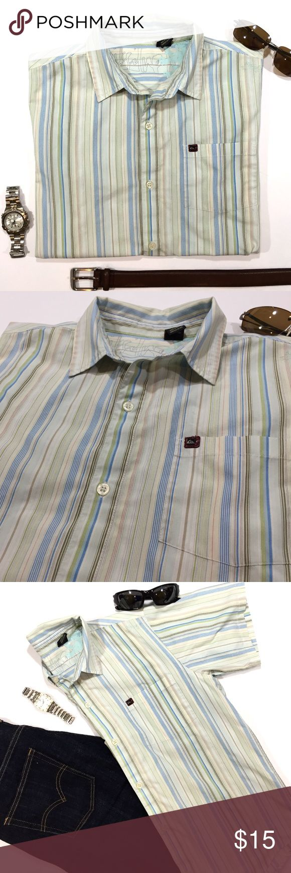 """Boys short sleeve collar QUIKSILVER shirt XL (20) Boy's short sleeve button down shirt by QUIKSILVER. Size: XL (20). Color: beige/white/blue/green/red/brown/gray stripes. Material: 65% Polyester, 35% Cotton. Has Quiksilver branding throughout: Quiksilver embroidered below left shoulder, Quiksilver tag shirt pocket, Quiksilver on all buttons, and Quiksilver clothing tag inside collar. Pre-worn but in great shape. Retails for $35!  Measurements: Length - 25"""" Shoulder to sleeve - 8.5"""" Armpit to…"""