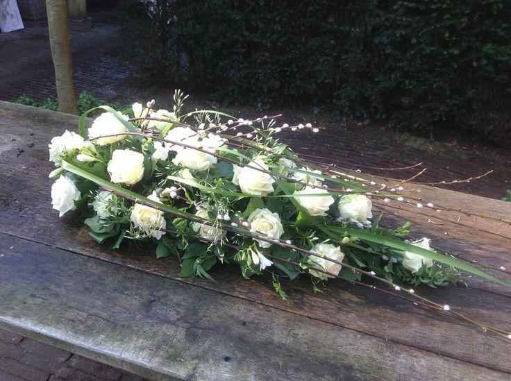 Funeral arrangement white