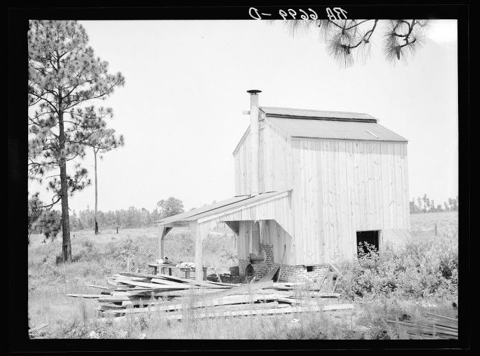 11. Flue cure tobacco barn on Irwinville Farms, Rural Resettlement Administration project at Irwinville, Georgia - June 1936