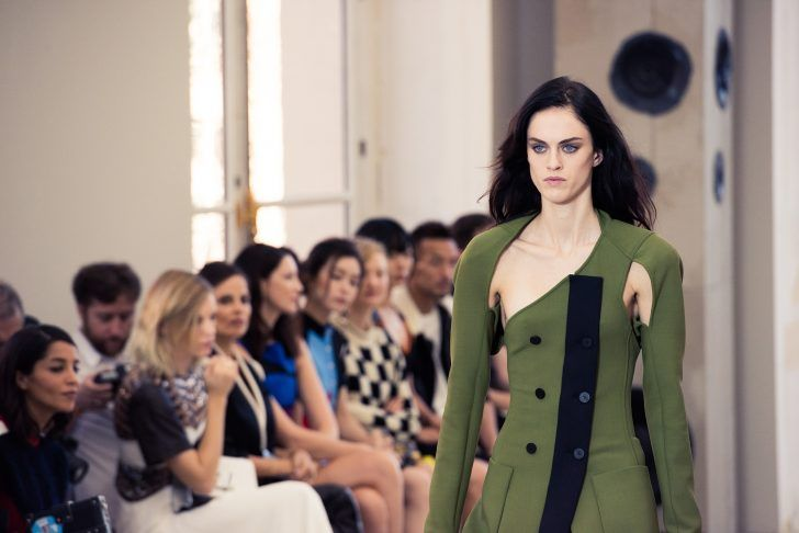 Inside Louis Vuitton's Spring 2017 Show: one-shoulder green dress with button front and detached long sleeve with cutouts | coveteur.com