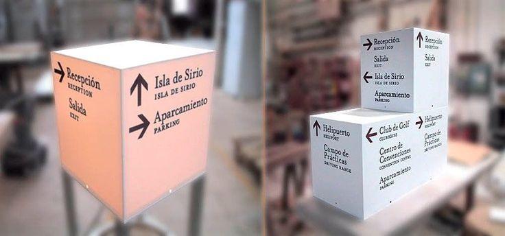 Cubos retroiluminados y grabados realizados en Corian®.