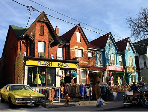 Kensington Market. Restaurants, vintage clothing, small boutiques. Also fresh fruit and vegetable shops, cheese stores, spice shops and butchers. Drink a beer at Ronnie's Local 069 and order a gourmet grilled cheese from across the street.