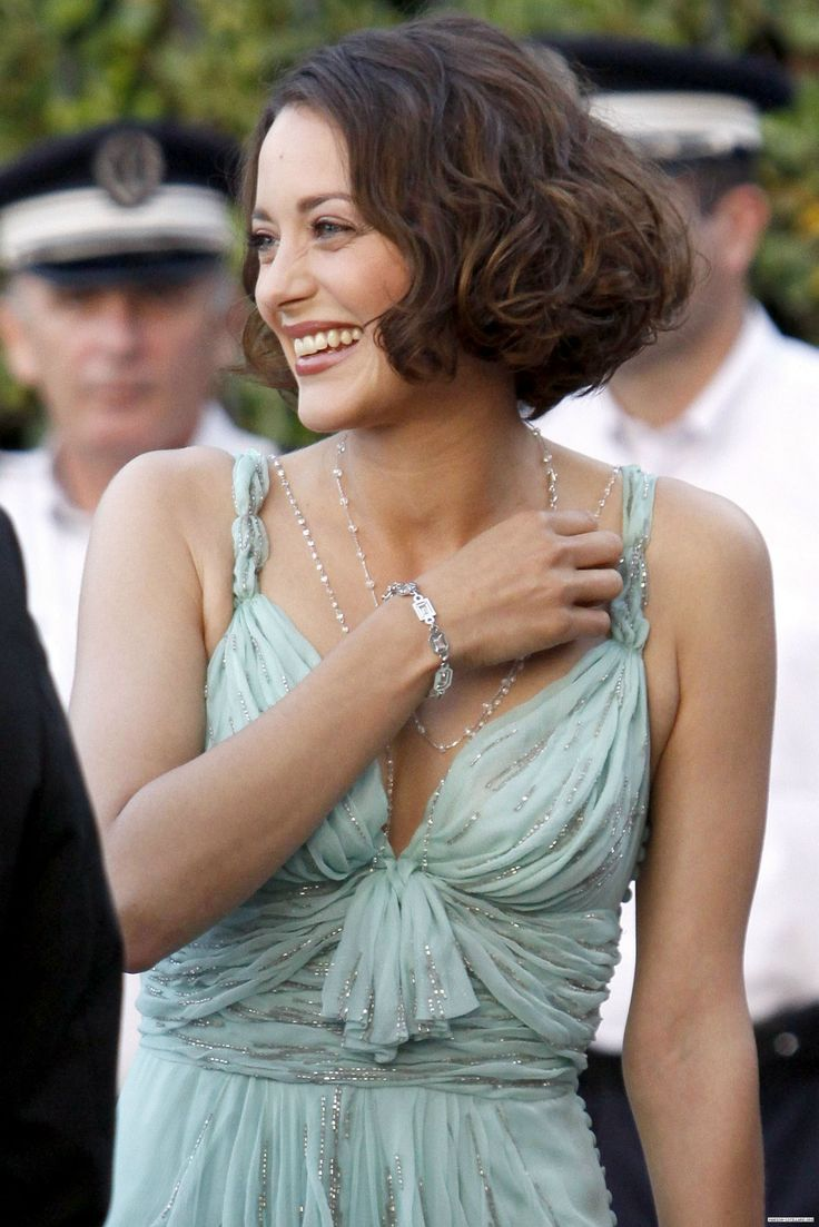 Marion Cotillard (in Dior) at amfAR's Cinema Against AIDS Annual Fundraising Gala during the 62nd Cannes Film Festival (2009)