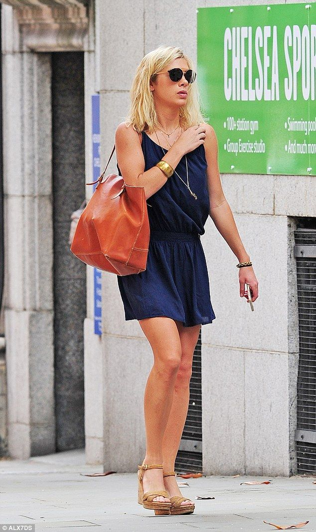 Chelsy Davy appeared unaffected by the heat as she went shopping in London this afternoon....