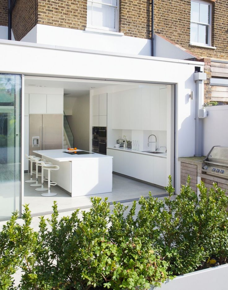 Modern kitchen extension with sliding glass wall