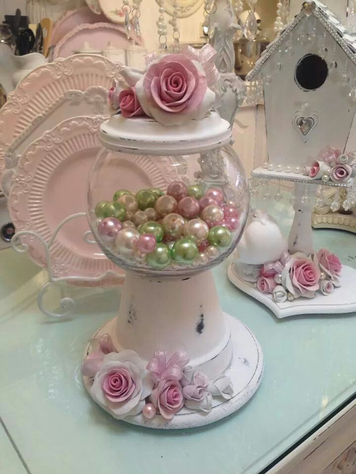 shabby chic terra cotta candy dish and in the background a bejeweled birdhouse