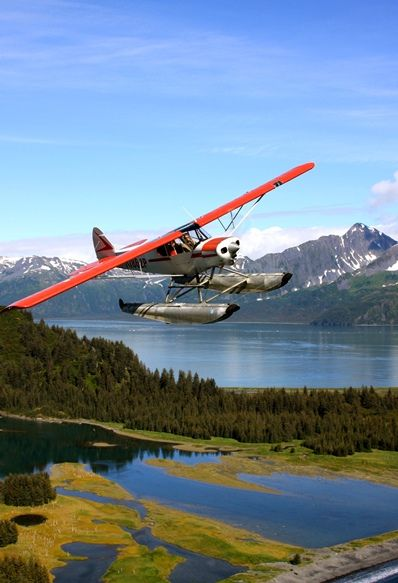 Southeast Alaskan float planes were (mid-70's) the main conveyance of transportation in the straits and sounds of the islands. The Cessna 180 Skywagon on amphibious floats was the work horse. It could carry four to six people, depending on how much gear they had. McC